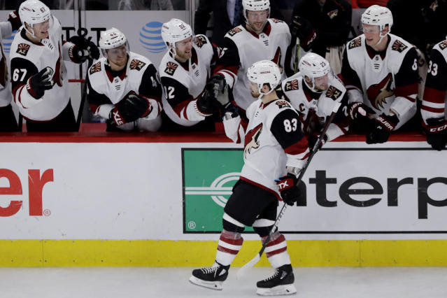 Arizona Coyotes right wing Conor Garland (83) celebrates with teammates after scoring a goal in a shootout of an NHL hockey game against the Chicago Blackhawks Sunday, Dec. 8, 2019, in Chicago. The Coyotes defeated the Blackhawks 4-3. (AP Photo/Nam Y. Huh)