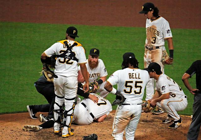 """<a class=""""link rapid-noclick-resp"""" href=""""/mlb/teams/pittsburgh/"""" data-ylk=""""slk:Pirates"""">Pirates</a> pitcher <a class=""""link rapid-noclick-resp"""" href=""""/mlb/players/9873/"""" data-ylk=""""slk:Nick Burdi"""">Nick Burdi</a> lays injured on the mound. (Photo by Justin K. Aller/Getty Images)"""