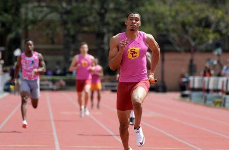 Mar 24, 2018; Los Angeles, CA, USA; Michael Norman runs the anchor leg on the Southern California Trojans 4 x 100m relay that won in 38.88 during the Power 5 Trailblazer challenge at Cromwell Field. Kirby Lee-USA TODAY Sports