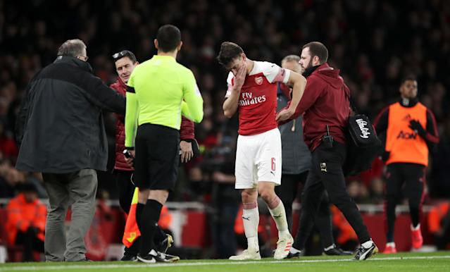 Laurent Koscielny suffered a suspected fractured jaw as Arsenal exited the FA Cup to United.