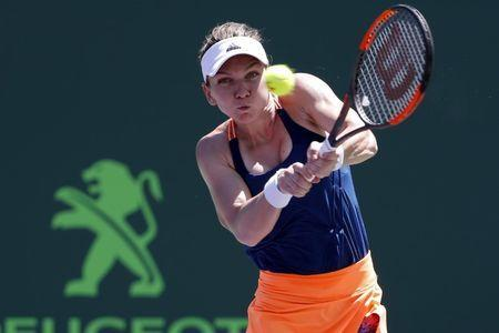 Mar 29, 2017; Miami, FL, USA; Simona Halep of Romania hits a backhand against Johanna Konta of Great Britain (not pictured) on day nine of the 2017 Miami Open at Crandon Park Tennis Center. Geoff Burke-USA TODAY Sports