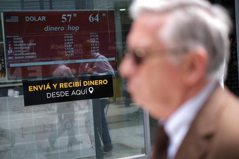 Argentina sets floor under peso as reserves dwindle