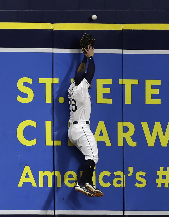 Tampa Bay Rays left fielder Tommy Pham can't reach a home run by Oakland Athletics' Khris Davis during the sixth inning of a baseball game Tuesday, June 11, 2019, in St. Petersburg, Fla. (AP Photo/Chris O'Meara)