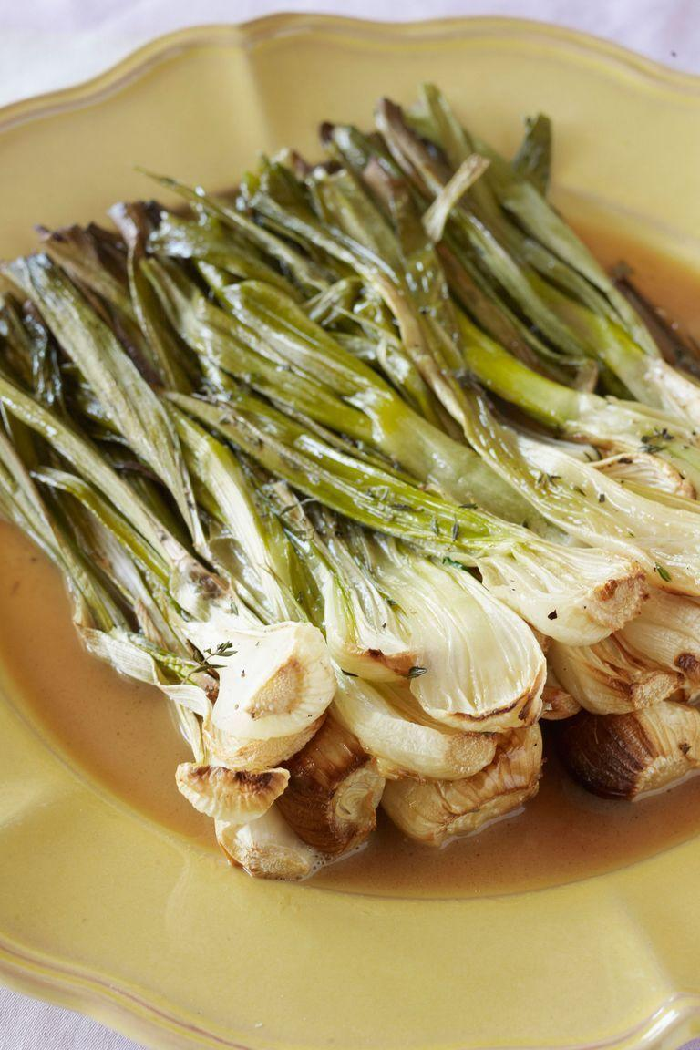 "<p>This no-fuss recipe is all about showcasing this fresh spring produce. By incorporating a few basic seasonings and cooking long enough to achieve caramelization, these onions become soft and sweet. </p><p><strong><em>Get the recipe at <a href=""https://www.countryliving.com/food-drinks/recipes/a3599/roasted-spring-onions-recipe-clx0411/"" rel=""nofollow noopener"" target=""_blank"" data-ylk=""slk:Country Living"" class=""link rapid-noclick-resp"">Country Living</a>.</em></strong></p><p><strong><em>_______________________________________________</em></strong><em><br><br><em>Want more Woman's Day? </em><a href=""https://subscribe.hearstmags.com/subscribe/womansday/253396?source=wdy_edit_article"" rel=""nofollow noopener"" target=""_blank"" data-ylk=""slk:Subscribe to Woman's Day"" class=""link rapid-noclick-resp""><em>Subscribe to Woman's Day</em></a><em> today and get </em><strong><em>73% off your first 12 issues</em></strong><em>. And while you're at it, </em><a href=""https://link.womansday.com/join/3o9/wdy-newsletter"" rel=""nofollow noopener"" target=""_blank"" data-ylk=""slk:sign up for our FREE newsletter"" class=""link rapid-noclick-resp""><em>sign up for our FREE newsletter</em></a><em> for even more of the Woman's Day content you want.</em><br></em></p>"