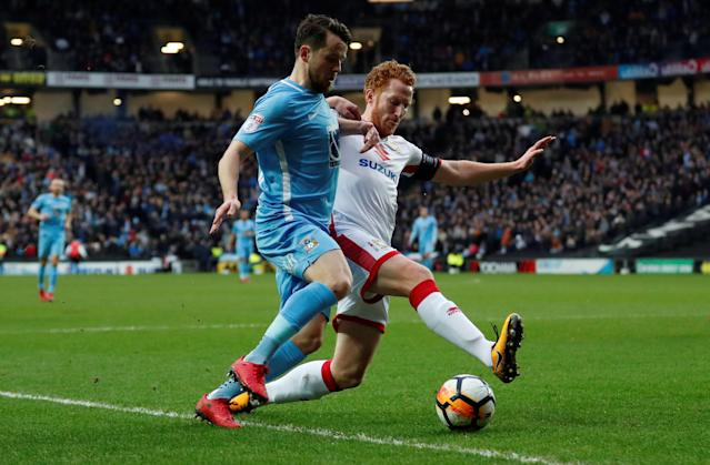 Soccer Football - FA Cup Fourth Round - Milton Keynes Dons vs Coventry City - Stadium MK, Milton Keynes, Britain - January 27, 2018 Coventry's Marc McNulty in action with MK Dons' Dean Lewington Action Images/Andrew Boyers