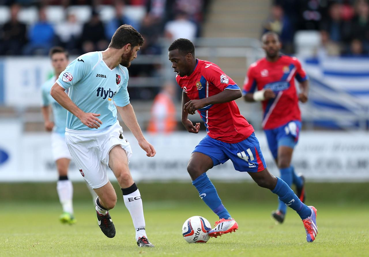 Dagenham & Redbridge's Zavon Hines (right) runs at Exeter City's Pat Baldwin during the Sky Bet Football League Two match at the London Borough of Barking and Dagenham Stadium, London.