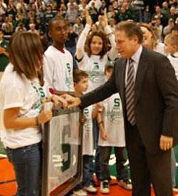 Michigan State coach Tom Izzo greets children participating in the Camouflage for Kids program