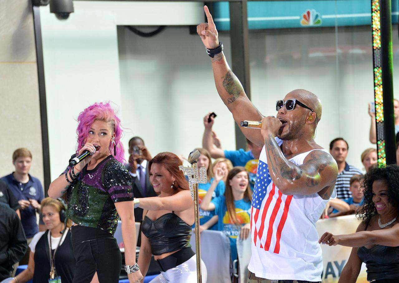 "NEW YORK, NY - JULY 06:  StayC (L) and rapper/singer Flo Rida perform on NBC's ""Today"" at Rockefeller Plaza on July 6, 2012 in New York City.  (Photo by Mike Coppola/Getty Images)"