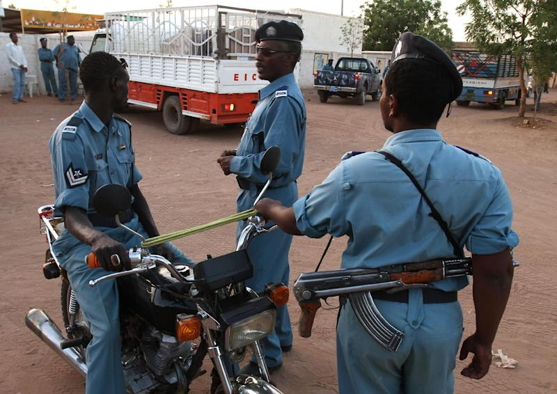 Sudanese police officers stand guard in Khartoum on April 10, 2010