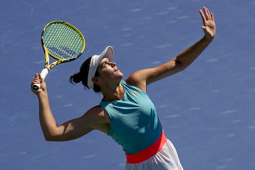Jennifer Brady, of the United States, serves to Angelique Kerber, of Germany, during the fourth round of the US Open tennis championships, Sunday, Sept. 6, 2020, in New York. (AP Photo/Seth Wenig)