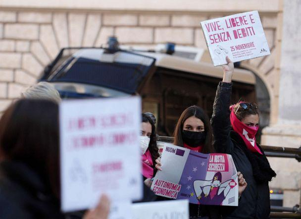 PHOTO: A woman show a banner reading 'alive, free and without debts' during a demonstration on the occasion of International Day for the Elimination of Violence against Women, in Rome, Nov. 25, 2020. (Alessandra Tarantino/AP, FILE)