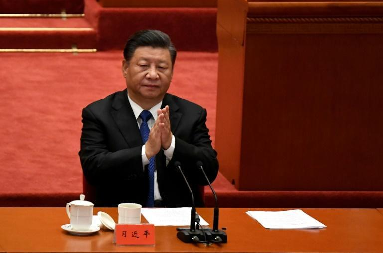 Chinese President Xi Jinping marks the 110th anniversary of the overthrow of the Qing Dynasty, which prompted the founding of the Republic of China, at the Great Hall of the People in Beijing on October 9, 2021 (AFP/Noel Celis)