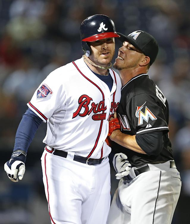Atlanta Braves pinch hitter Ryan Doumit (4) is tagged out by Miami Marlins starting pitcher Jose Fernandez (16) after hitting a ground ball to Fernandez in the eight inning of a baseball game Tuesday, April 22, 2014 in Atlanta. (AP Photo/John Bazemore)