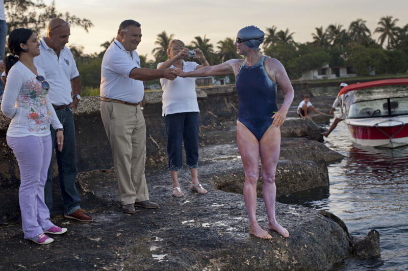 British-Australian swimmer Penny Palfrey says goodbye before beginning her bid to complete a record swim from Cuba to Florida, in Havana, Cuba, Friday, June 29, 2012. Palfrey aims to be the first woman to swim the Straits of Florida without the aid of a shark cage. Instead she's relying on equipment that surrounds her with an electrical field to deter the predators. (AP Photo/Ramon Espinosa)