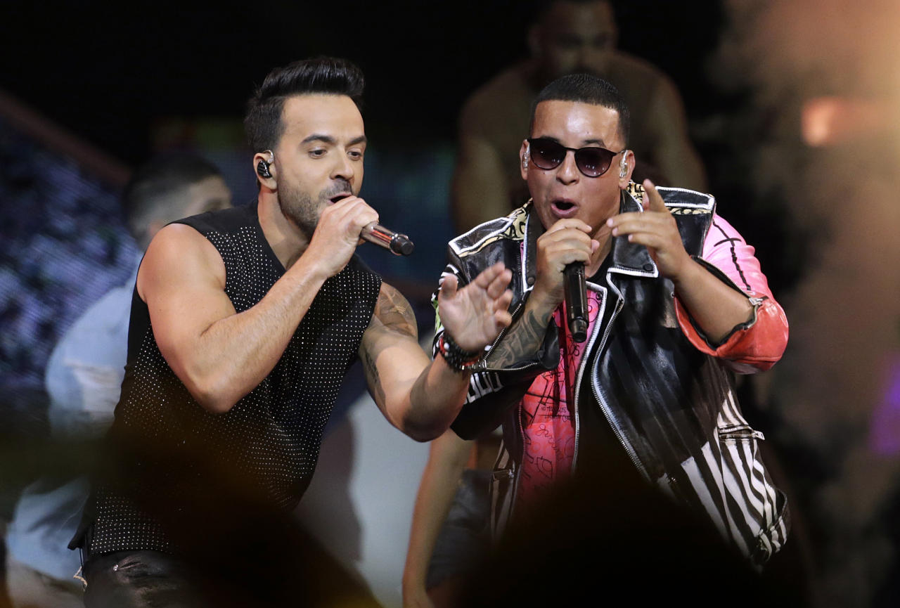 "FILE - In this April 27, 2017, file photo, singers Luis Fonsi, left, and Daddy Yankee perform during the Latin Billboard Awards in Coral Gables, Fla. ""Despacito"" dominated 2017, but it's still bringing success to Luis Fonsi and Daddy Yankee: The artists are the leading nominees at the iHeartRadio Music Awards. IHeartMedia announced Wednesday, Jan. 10, 2018, that Fonsi and Yankee scored seven nominations each, including song of the year for the tune's version with Justin Bieber. (AP Photo/Lynne Sladky, File)"
