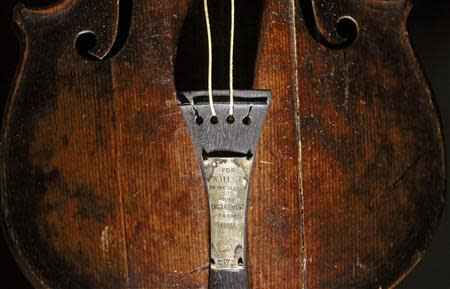File photograph shows the violin that belonged to Titanic bandmaster Wallace Hartley on display at the Titanic Centre in Belfast
