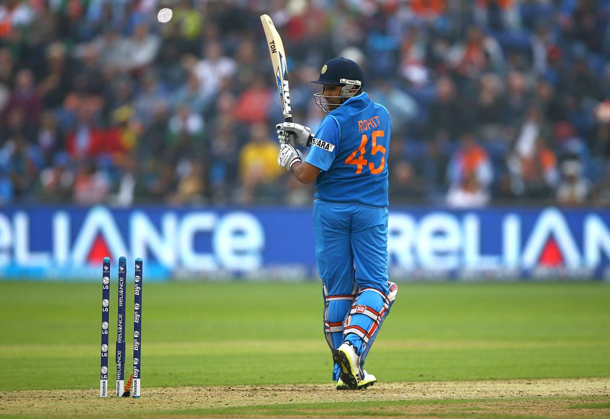 Rohit Sharma of India looks on, after being bowled by Angelo Mathews of Sri Lanka during the ICC Champions Trophy Semi Final match between India and Sri Lanka at SWALEC Stadium on June 20, 2013 in Cardiff, Wales.  (Photo by Matthew Lewis-ICC/ICC via Getty Images)
