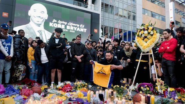 PHOTO: Fans gather at L.A. Live in Los Angeles to pay their respects to former Los Angeles Lakers guard Kobe Bryant who died in helicopter crash on Sunday. (Sandy Hooper/USA TODAY Sports)