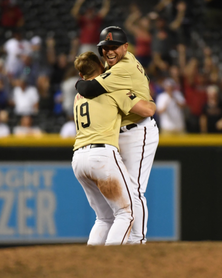 The Diamondbacks' Asdrubal Cabrera celebrates with Josh VanMeter after getting the game-winning hit against the Dodgers.