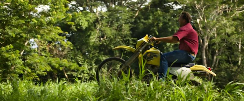Spanish lookout, Belize - September 2, 2018 Henry Plett riding off road with his Suzuki Drz250 at Mennonite beach