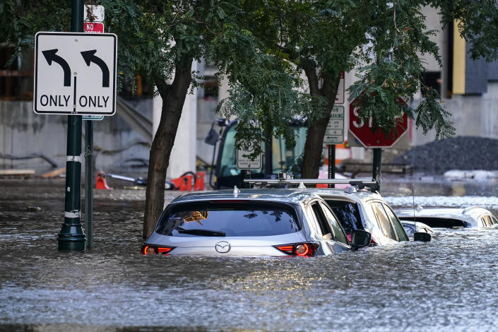 Philadelphia streets with half-submerged cars on Thursday, after the tail end of Hurricane Ida hit.