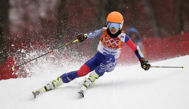 Violinst Vanessa Mae, starting under her father's name as Vanessa Vanakorn for Thailand, makes a turn in the first run of the women's giant slalom at the Sochi 2014 Winter Olympics, Tuesday, Feb. 18, 2014, in Krasnaya Polyana, Russia. (AP Photo/Charles Krupa)
