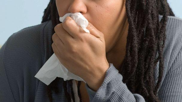 PHOTO: A woman coughs into a tissue in an undated stock photo. (STOCK PHOTO/Getty Images)