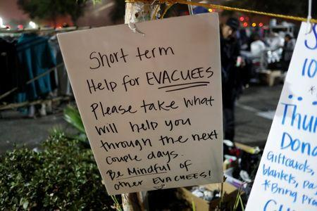 A sign hangs at a makeshift evacuation center for people displaced by the Camp Fire in Chico, California, U.S., November 15, 2018.  REUTERS/Terray Sylvester