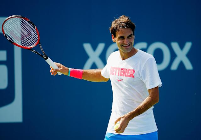 Roger Federer of Switzerland smiles during practice prior to the start of the 2014 US Open at the USTA Billie Jean King National Tennis Center on August 21, 2014 in New York City (AFP Photo/Chris Trotman)