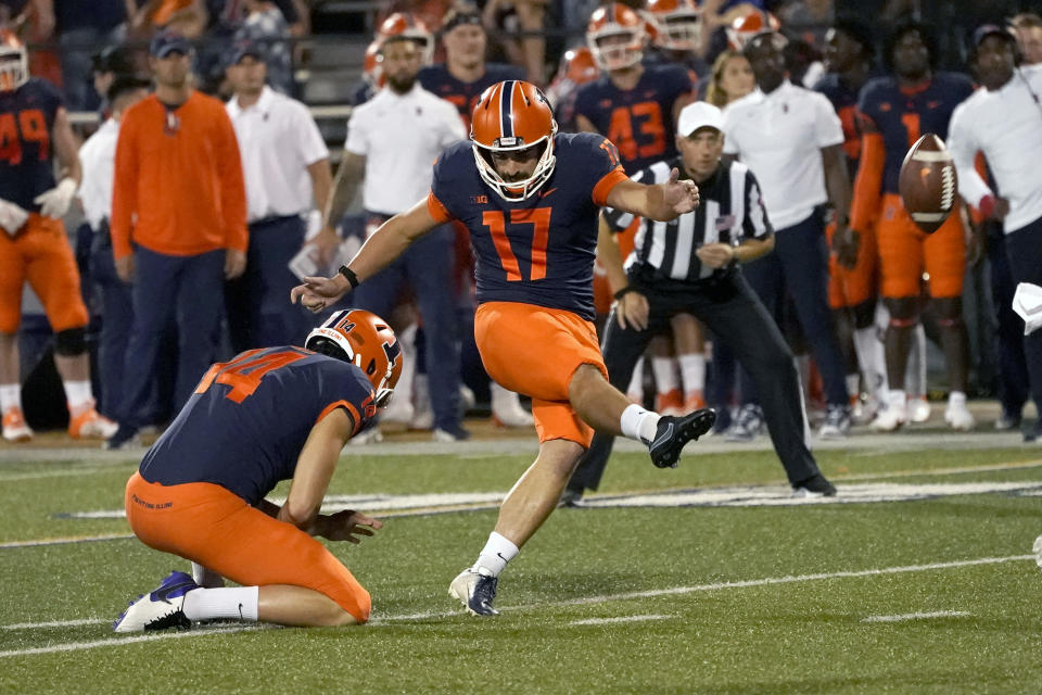 Illinois place kicker James McCourt kicks a field goal off the hold of Blake Hayes during the first half of an NCAA college football game Friday, Sept. 17, 2021, in Champaign, Ill. (AP Photo/Charles Rex Arbogast)
