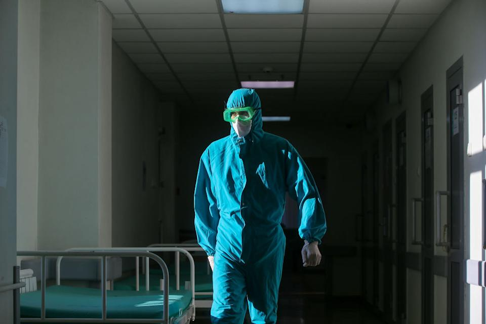 A medical staff member wears a protective suit at an infectious diseases department at Tatarstan's Republican Clinical Hospital in Russia.