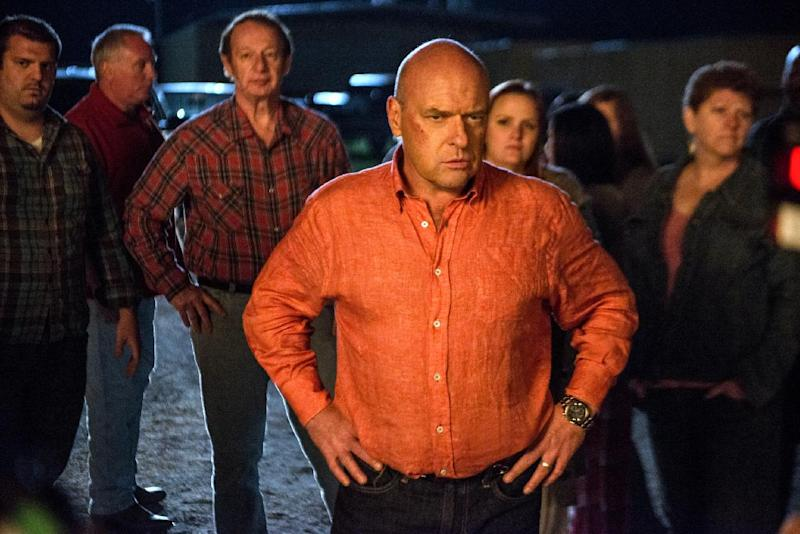 "This publicity image released by CBS shows Dean Norris as James ""Big Jim"" Rennie, a town leader on the series ""Under the Dome,"" airing Mondays at 10 p.m. on CBS. Norris will also appear in the final season of the hit series ""Breaking Bad,"" premiering Sunday at 9 p.m. EST on AMC. (AP Photo/CBS, Brownie Harris)"