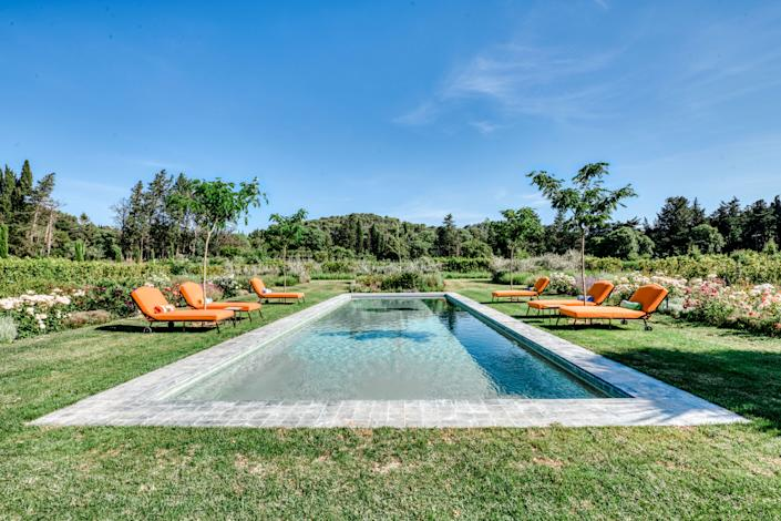 "<div class=""caption""> The pool was one of the first things put in by Douzal after closing on the property. The furniture is from <a href=""http://www.herve-baume.com/"" rel=""nofollow noopener"" target=""_blank"" data-ylk=""slk:Hervé Baume"" class=""link rapid-noclick-resp"">Hervé Baume</a>. </div>"