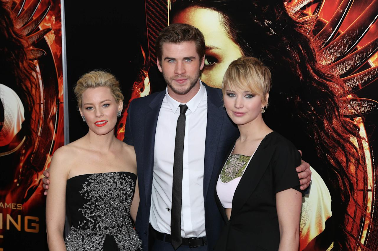 "NEW YORK, NY - NOVEMBER 20: (L-R) Elizabeth Banks, Liam Hemsworth and Jennifer Lawrence attend a special screening of ""The Hunger Games: Catching Fire"" on November 20, 2013 in New York City. (Photo by Rob Kim/Getty Images)"
