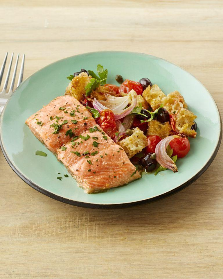 """<p>Sheet pan dinners like this one are ideal for busy weeknights (or any time you just don't feel like washing a bunch of pots and pans), and salmon is the perfect protein for them because it cooks so quickly. You'll love how it tastes with crispy bread cubes and homemade puttanesca sauce. <br></p><p><strong><a href=""""https://www.thepioneerwoman.com/food-cooking/recipes/a32392257/sheet-pan-salmon-puttanesca-recipe/"""" rel=""""nofollow noopener"""" target=""""_blank"""" data-ylk=""""slk:Get Ree's recipe."""" class=""""link rapid-noclick-resp"""">Get Ree's recipe.</a> </strong> </p>"""