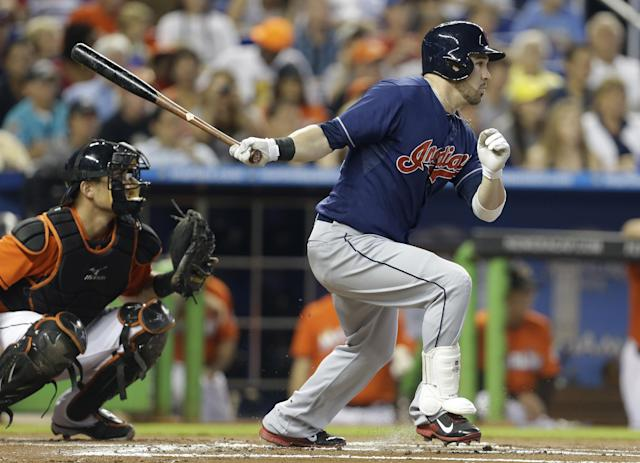 Cleveland Indians' Jason Kipnis follows through on a single in the first inning as Miami Marlins catcher Jeff Mathism left, watches during an interleague baseball game, Sunday, Aug. 4, 2013, in Miami. (AP Photo/Lynne Sladky)