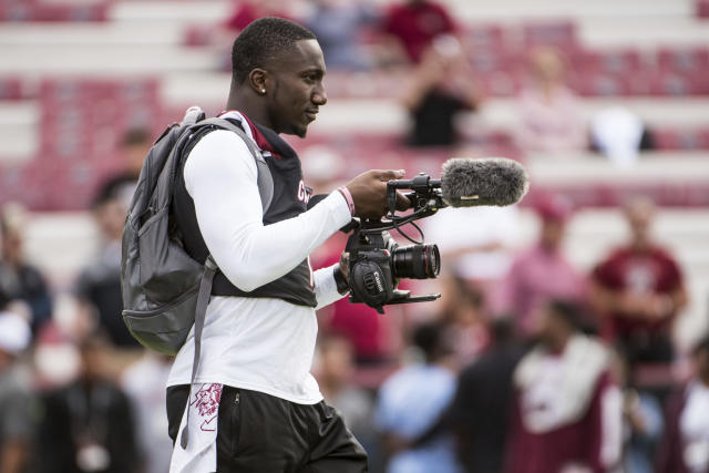"South Carolina wide receiver <a class=""link rapid-noclick-resp"" href=""/ncaaf/players/242964/"" data-ylk=""slk:Deebo Samuel"">Deebo Samuel</a> films his teammates during warm-ups before the start of an NCAA college football game Saturday, Oct. 28, 2017, in Columbia, S.C. South Carolina defeated Vanderbilt 34-27. (AP Photo/Sean Rayford)"