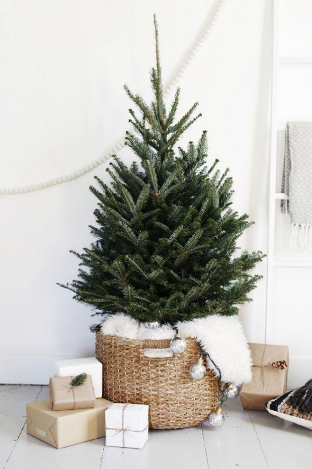 "<p>You don't have to go all out for your festive display to look amaze. This year, try a pared down, minimalist vibe. </p><p>See more at <a href=""http://themerrythought.com/diy/simple-christmas-tree-display/"" rel=""nofollow noopener"" target=""_blank"" data-ylk=""slk:The Merrythought"" class=""link rapid-noclick-resp"">The Merrythought</a>.</p>"