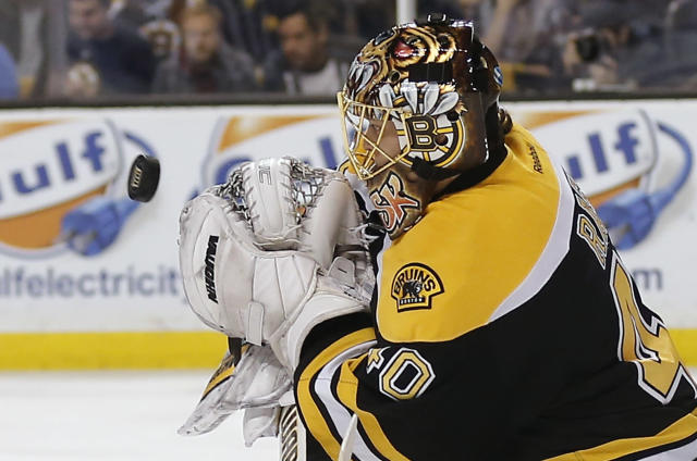 Boston Bruins goalie Tuukka Rask, of Finland, makes a save against the Buffalo Sabres during the first period of an NHL hockey game in Boston, Saturday, Dec. 21, 2013. (AP Photo/Winslow Townson)