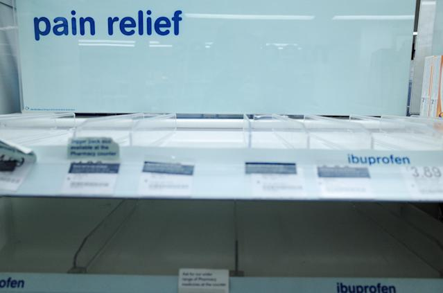 Empty shelves usually stocked with pain relief medication are seen at a branch of Boots chemist in Paddington Station in London, England, on 14 March 14, 2020. (Photo by David Cliff/NurPhoto via Getty Images)