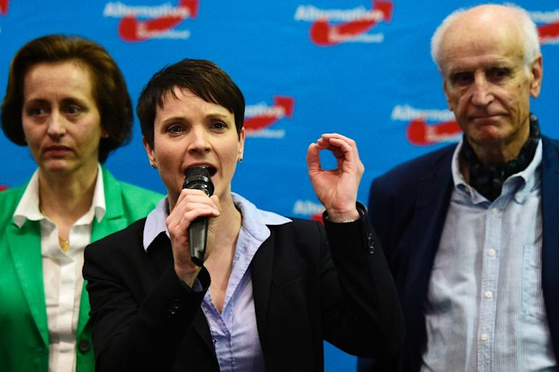 Frauke Petry, head of the right-wing populist party Alternative for Germany party addresses supporters after state elections exit poll results are announced on tv in Berlin on March 13, 2016 (AFP Photo/John MacDougall)