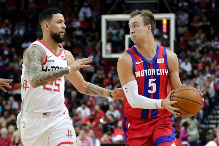 Detroit Pistons guard Luke Kennard looks to pass as Houston Rockets guard Austin Rivers defends during the first half Saturday, Dec. 14, 2019, in Houston.