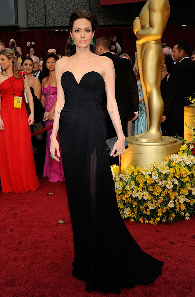 Angelina Jolie   Grade: A+       The A-list actress kept it sexy yet sophisticated in a black strapless Elie Saab gown, emerald Lorraine Schwartz earrings, and a marvelous matching cocktail ring.