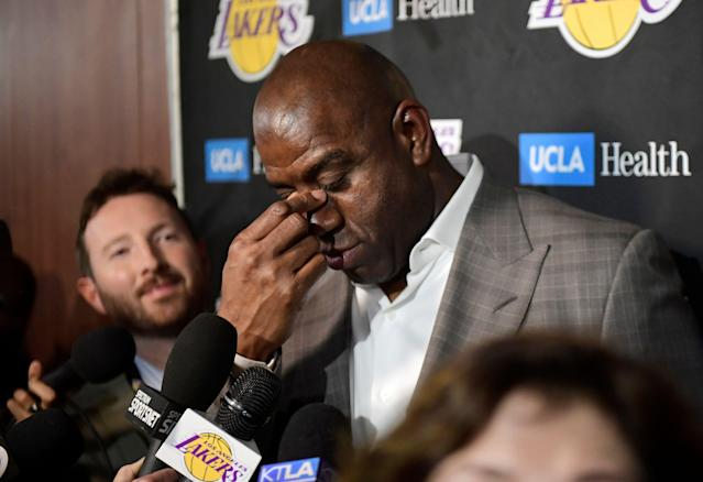 Magic Johnson is attempting to be a cheerleader for the Lakers while airing out the franchise's dirty laundry -- a confluence of ideas that doesn't work. (AP)