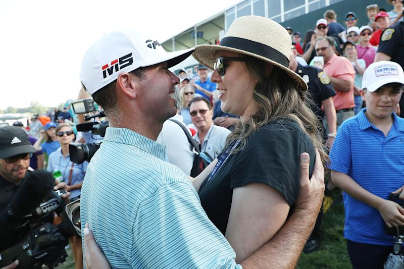 Chez Reavie celebrates with wife Amanda Henrichs after winning the 2019 Travelers Championship.