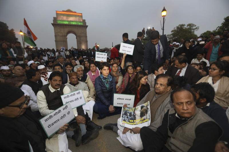 Congress party leader Priyanka Gandhi, center, joins other leaders during a sit in protest against a new citizenship law near the India Gate monument in New Delhi, India, Monday, Dec.16, 2019. The new law gives citizenship to non-Muslims who entered India illegally to flee religious persecution in several neighboring countries. (AP Photo/Manish Swarup)
