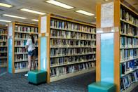 Hong Kong's libraries earlier said they were pulling titles deemed to breach the new security law for a review (AFP Photo/ISAAC LAWRENCE)