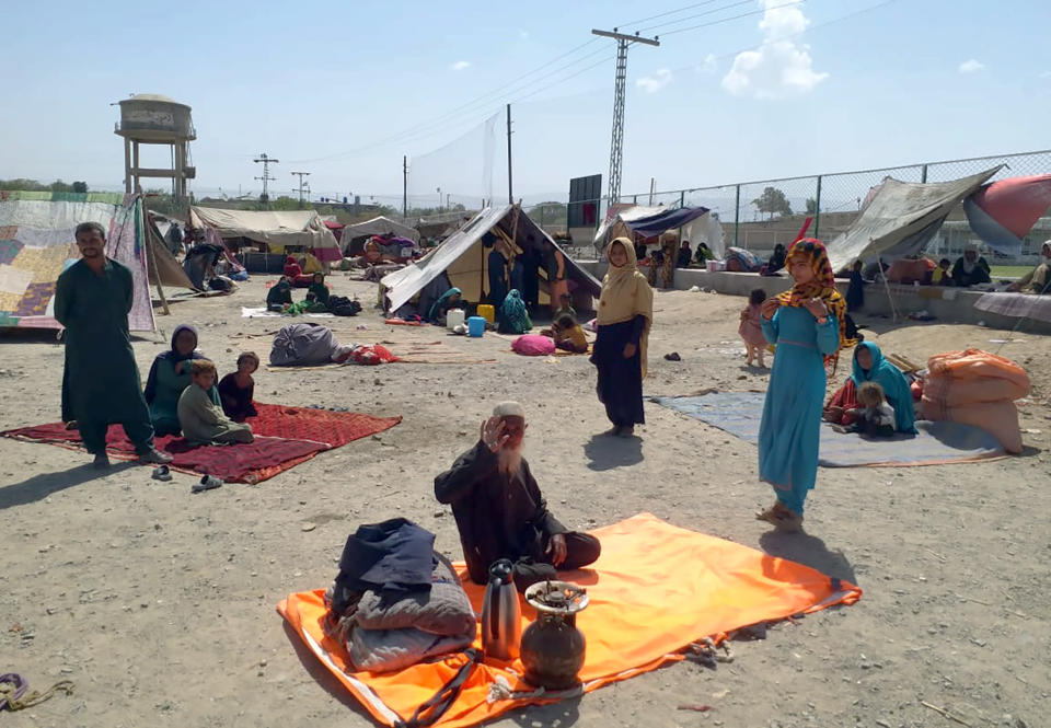 Afghan families sit outside their tents in an open area on the outskirts of Chaman, a border town in the Pakistan's southwestern Baluchistan province, Wednesday, Sept.1, 2021. Dozens of Afghan families have crossed into Pakistan through the southwestern Chaman border a day after the U.S. wrapped up its 20-year military presence in the Taliban-controlled country. (AP Photo/Jafar Khan)