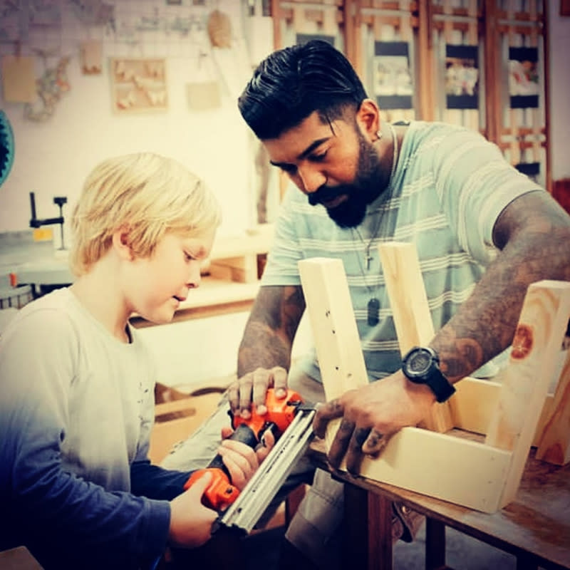 Nicholas Pereira teaching a student wood working before the pandemic. — Picture courtesy of Nicholas Pereira