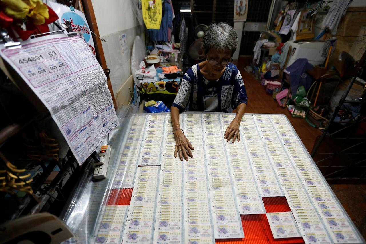 REFILE - REMOVING EXTRA WORD A vendor arranges lottery tickets for sale as she waits for customers at her shop in Bangkok's suburbs, Thailand May 26, 2017. REUTERS/Chaiwat Subprasom